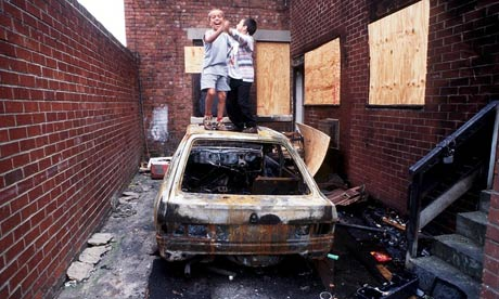 English children playing on a burned-out car in England. This isn't a parody, or a photoshop, this is the state of Britain in 2014. Sometimes even satire doesn't seem sufficient.